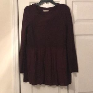Wine colored sweater with ruffled bottom accent